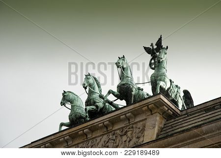 Detail Of The Quadriga Of The Brandenburg Gate, German: Brandenburger Tor, Is A City Gate And One Of