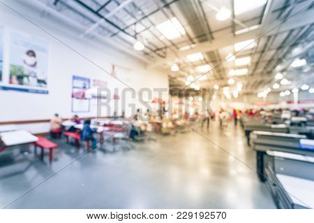 Blurred Food Court Picnic Tables At Wholesale Store In Usa