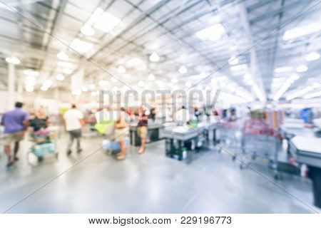 Blurred Long Queue At Wholesale Store Checkout Counter In America
