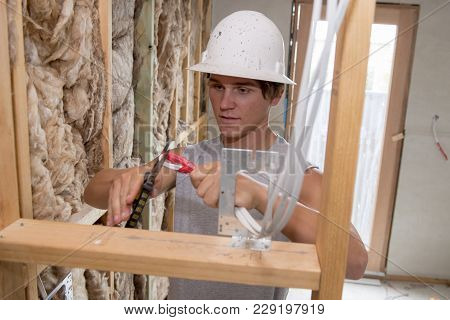 Young Attractive And Confident Builder And Constructor Job Trainee Learning Working At Industrial El