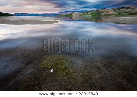 Dramatic Sky Mirrored on Lake Laberge Yukon Canada
