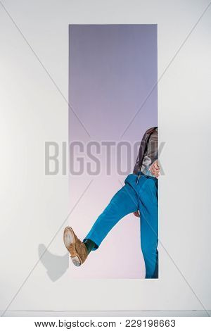 Cropped Image Of Man In Stylish Clothes Going Through Frame On White