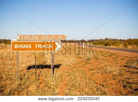Binns Track signage off the Plenty Hwy near Alice Springs, Northern Territory, Australia. Famous for gem fossicking. poster