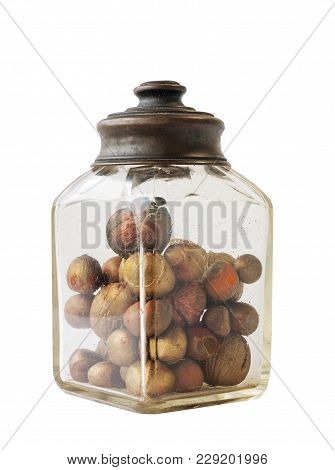 Old Jar With Nuts And Hazelnuts On White Background
