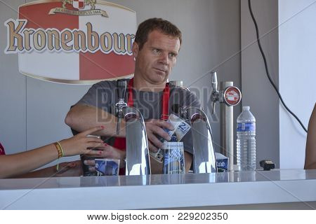 Le Mans, France - June 12, 2014: The Barman Pours Beer Into A Glass In Pub At 24 Hours Races Of Le M