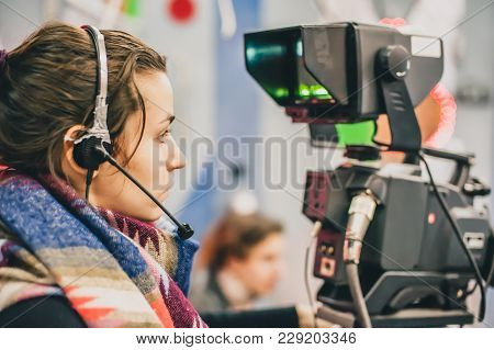 Behind The Scene. Female Cameraman Shooting Film Scene With Camera