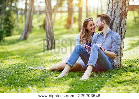 Cute Uni Students Studying Together In Nature