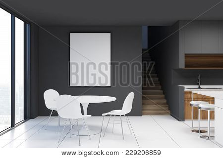 Dark Gray Dining Room Interior With A White Table And Chairs, Dark Wooden Countertops And A White Ti