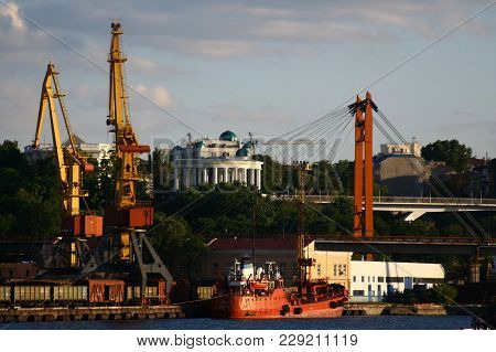 Logistics And Transportation Of International Container Cargo Ship With Working Crane Bridge In Seap