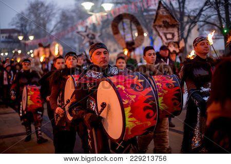 Pernik, Bulgaria - January 26, 2018: Male Musician In Carnival Costume, Part Of Drummer Group Drums