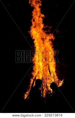 Pernik, Bulgaria - January 26, 2018: Two Men Speak In Front Of The Giant Ritual Fire At The Internat
