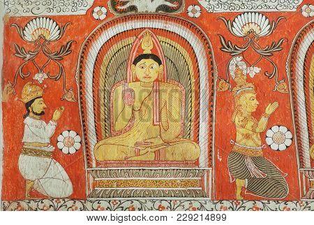 Kandy, Sri Lanka - Jan 7, 2018: People Worshiping Buddha On Fresco Of The 14th Century Temple Lankat