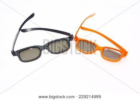 3d Glasses In Orange And Black Frames On A White Background. View From Above