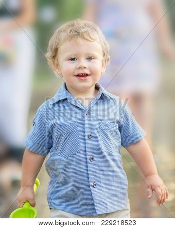 A Happy Smiling Baby Boy Playing At Summer Park. A Walking Family With A Cute Little Son Outside. Ou