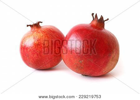 Two Ripe Pomegranate Isolated On White Background. Healthy Food.