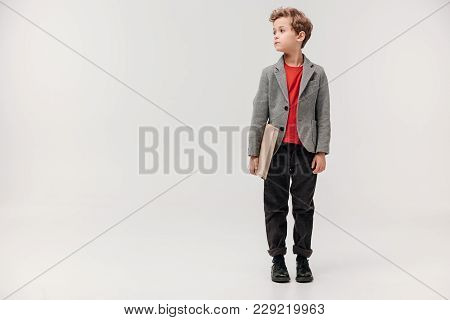 Stylish Little Schoolboy With Big Book Isolated On Grey