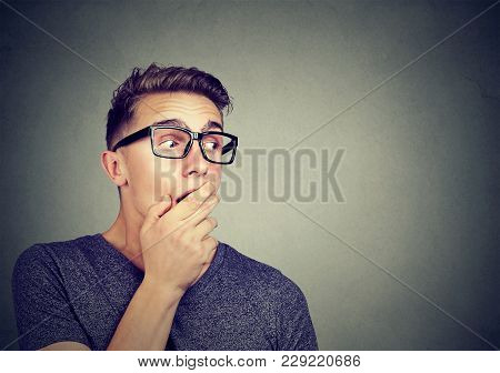 Young Amazed Man In Casual Outfit And Eyeglasses Looking Away Excited With Gossip.