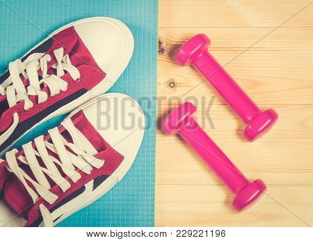 Sport Shoes On Yoga Mat And  Dumbbells