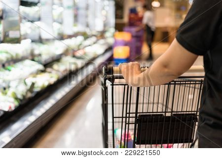 Close Up Shopper Wifehouse Woman's Hand Is Pushing A Shopping Cart At Supermarket, Retail, Supermart