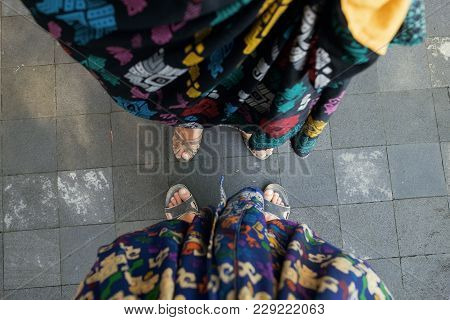 View On Sarong And Shoes. Couple Wear Traditional Clothes In Bali, Indonesia To Enter A Temple