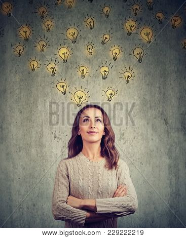 Young Happy Woman Contemplating And Looking Up Has Many Bright Ideas