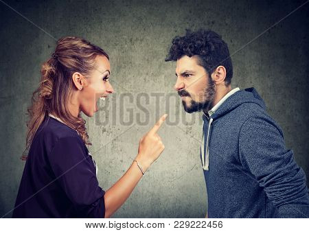 Quarrel Between Young Angry Man And Frustrated Woman