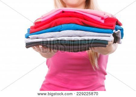 Household Duties, Domestic Chores Concept. Happy, Proud Woman Holding Folded Colorful Clothes After