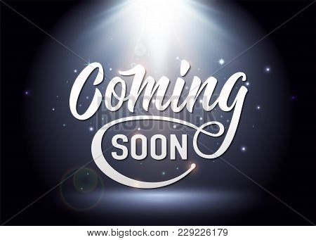 Coming Soon Sign. Promotion Announcement Banner With Light White Text, Shine Particles On Spotlight