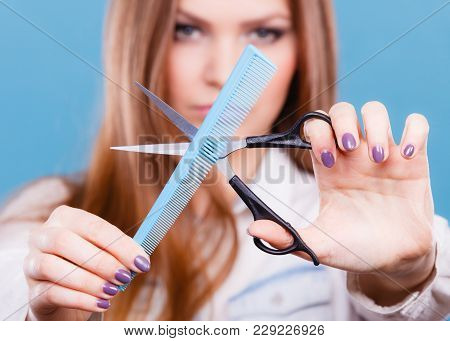 Change Of Look, New Image. Young Girl Presents Comb And Scissors. Female Stylist Preparing Equipment