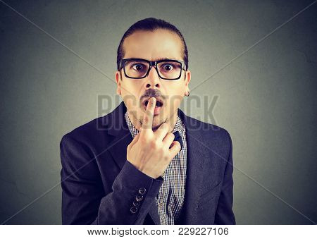 Young Elegant Man Touching Lips Looking Shocked At Camera Under Great Impression.