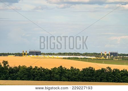 Agro-industrial Complex On The Horizon. Agricultural Landscape.