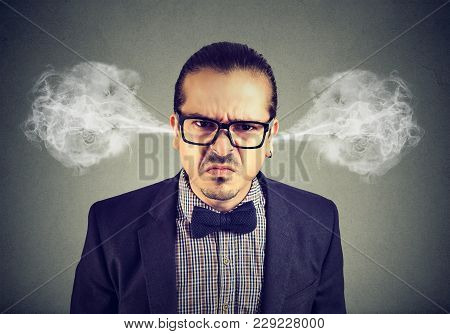 Angry Business Man, Blowing Steam Coming Out Of Ears, About To Have Nervous Breakdown Isolated On Gr
