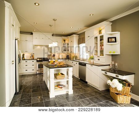 White Modern Wood Kitchen With Breakfast On Counter Top