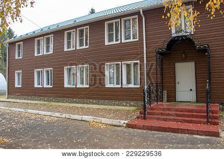 Photo Of Two-storey Motel With Entry In Autumn