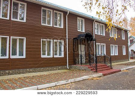 Photo Of Two-floor Motel With Entry In Autumn