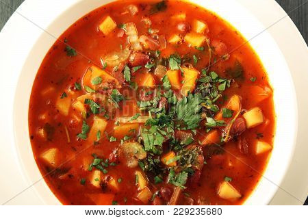 Tomato Soup With Red Beans, Potato And Carrot. Vegan. European Cuisine. Top View. Vegetarian Dish. M