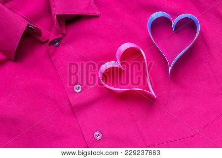 Hearts On The Background Of A Red Shirt Pocket. The Concept Of Valentine's Day.