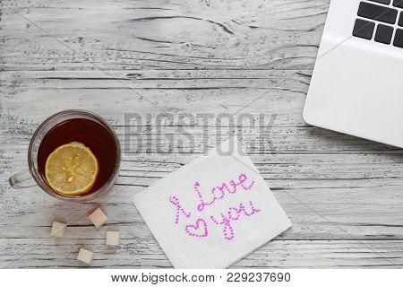 Background Of A Valentine On A Wooden Table With A Laptop And A Cup Of Tea With Lemon Next To A Napk