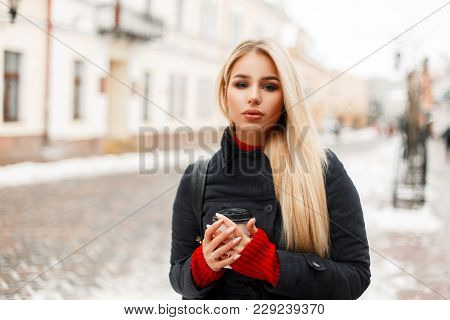 Beautiful Young Stylish Woman Model With Coffee In A Trendy Vintage Coat Hood Walking Outdoors In Th
