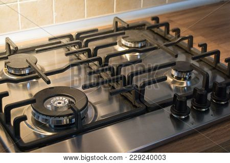 Gas Cooker Close-up. Kitchen Necessity. Four Burners. Food