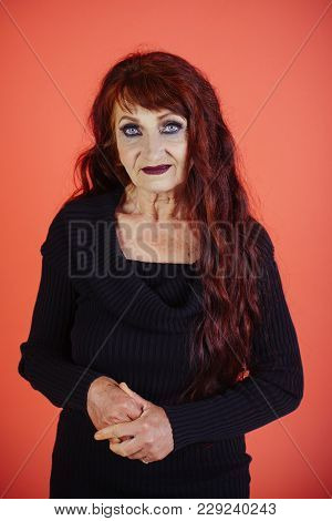 Woman With Long Dyed Hair Color, Hairstyle. Senior Model With Wrinkled Face, Aging Skin, Makeup, Loo