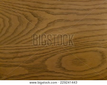 The Lighly Coloured Grain Of The Wooden Surface
