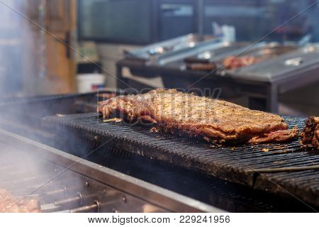 The Process Of Cooking Shish Kebab On A Metal Grill In The Open Air.grilling Shashlik On Barbecue Gr