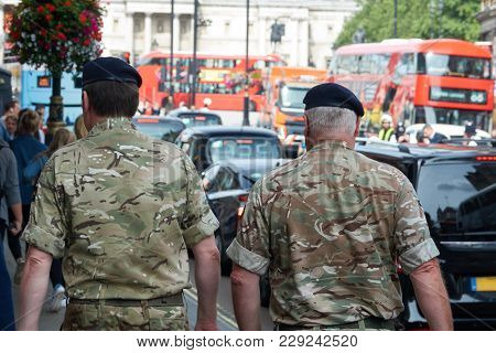 Fight Against World Terrorism In Europe. Military Patrol The Streets Of London.