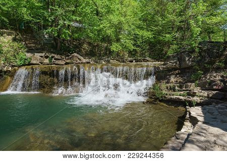 A Small Picturesque Waterfall Of The Mountain River Janet. Russia, Gelendzhik, Village Vozrozhdenie
