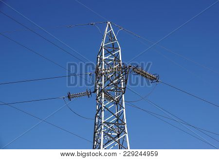 High-voltage Power Lines. Electricity Distribution Station . High Voltage Electric Transmission Towe