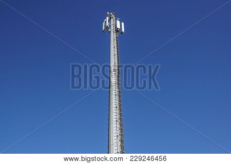 Technology On The Top Of The Telecommunication Gsm Tower Antenna, Transmitter , Blue Sky, White Clou