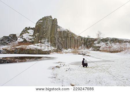 Outdoor Photographer Takes Photo Of Snowy Panska Rocks Formation, National Park Czech Switzerland, C