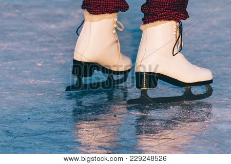 Close-up Of Woman Skating On Ice