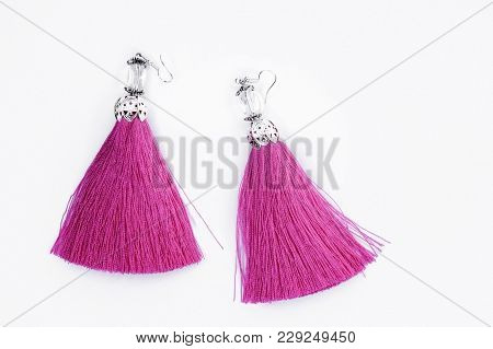Pink Handmade Earrings On A White Background.